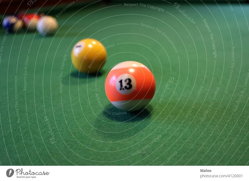 Colored pool balls on a green pool table sport snooker leisure sphere color competition game gambling group number recreational billiard play hobbies cue fun