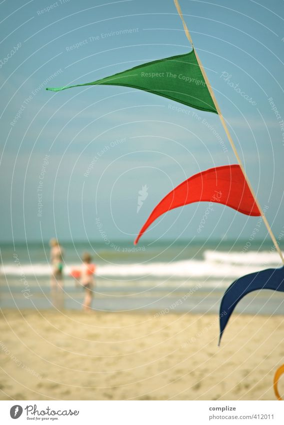 at the beach Well-being Relaxation Children's game Vacation & Travel Tourism Summer Summer vacation Sun Sunbathing Beach Ocean Island Waves Swimming & Bathing