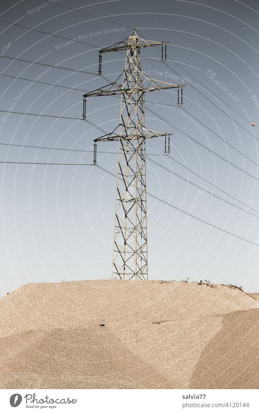 Power pole stands on an island in the gravel pit Energy industry gravel mining Gravel plant Industry Electricity High voltage power line Technology