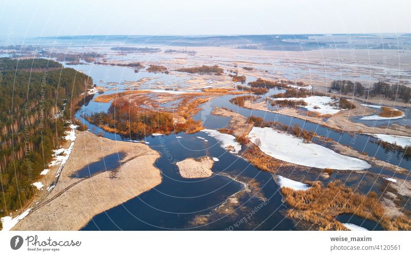 Spring melting river flood aerial panorama. Overflow water at springtime overflow deluge inundation floodwaters spate alluvion view environment beautiful forest