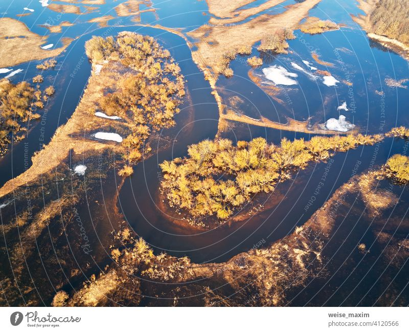 Spring melting river flood aerial panorama. Overflow water at springtime. overflow deluge inundation floodwaters spate alluvion view environment beautiful