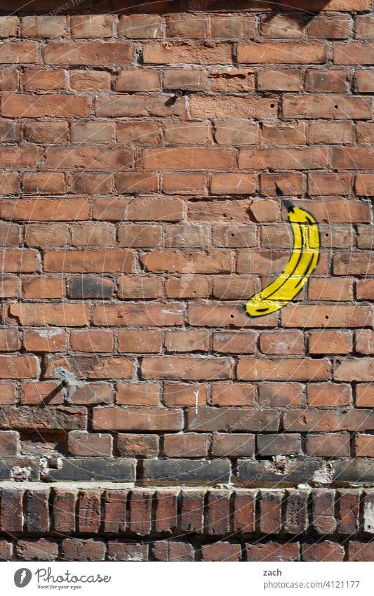 bananas of all things Facade Wall (building) House wall Wall (barrier) Banana Fruit Graffiti brick bricks