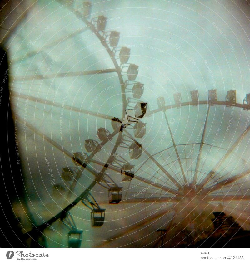 double pleasure Analog Double exposure Scan Town Lomography Slide Experimental Holga Ferris wheel Amusement Park Ferris wheel ride gondola fun