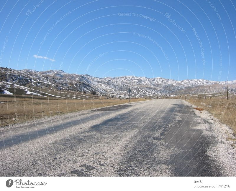 road into nothing Far-off places Summer Turkey Country road Europe Street Mountain Infinity Snow Loneliness