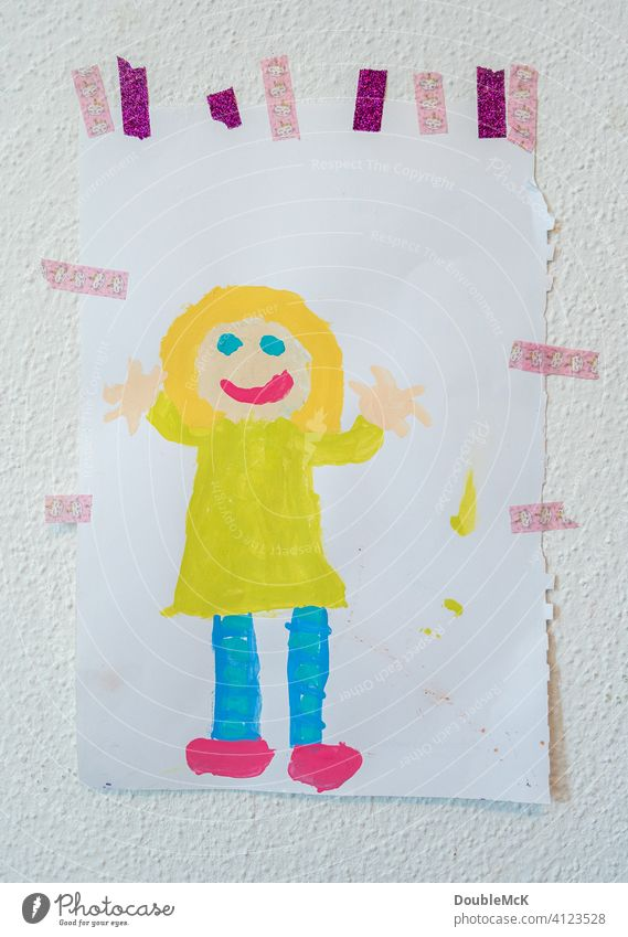 A child's picture pasted on the wall, depicting a cheerful girl, painted with watercolours Wall (building) childhood photograph Children's drawing Drawing Girl
