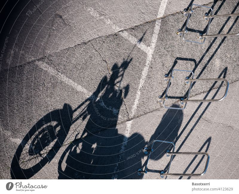 Shadow of a parked motorcycle in the late afternoon Motorcycle Classic Transport Parking lot turned off Vehicle Rocker Lifestyle Deserted Street Exterior shot