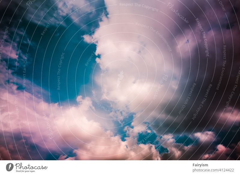pastel colored sky with fluffy clouds Sky Exterior shot Multicoloured Clouds Sunlight Summer Beam of light background Sky blue Abstract Colour photo backgrounds