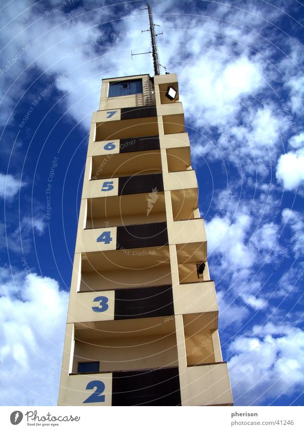 Sky Blue House (Residential Structure) Clouds Architecture Tall Tower Digits and numbers Story Antenna Fire department