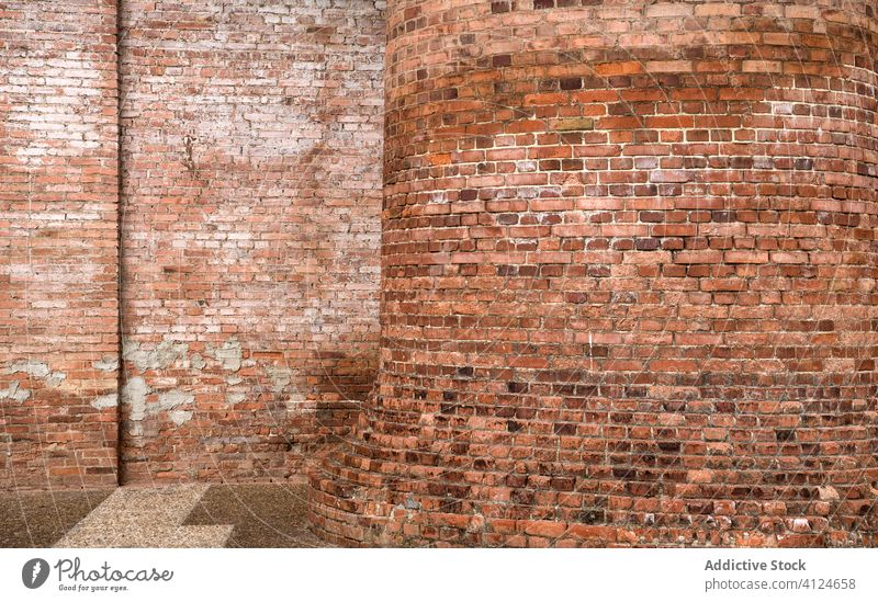 Exterior of shabby brick building of factory wall exterior grunge industrial rough architecture dirty sunny daytime facility weathered aged old structure