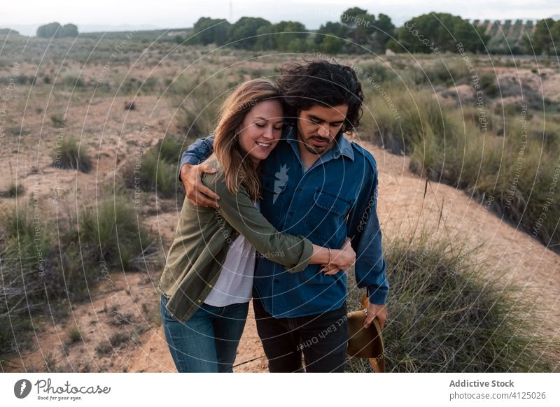 Happy couple walking in countryside evening date love bush happy tender sunset man woman cheerful romantic lifestyle smile leafless nature relationship together