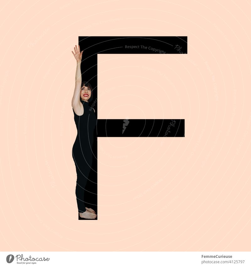 Graphic shows black letter F of the Latin alphabet against a skin-colored background and integrated photographic full-body shot of a posing brunette woman with bob hairstyle in black one-piece suit