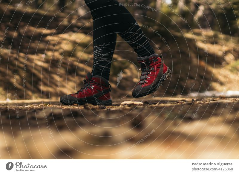 side view of hiking boots walking in the mountain travel snowy nature copy space trekking footwear adventure hike shoe tourism lifestyle activity outdoor trail