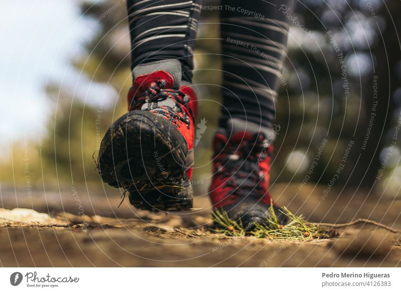 Close- up of hiking boots walking in the mountain travel nature copy space adventure trekking hiker shoe healthy lifestyle summer active exercise people foot