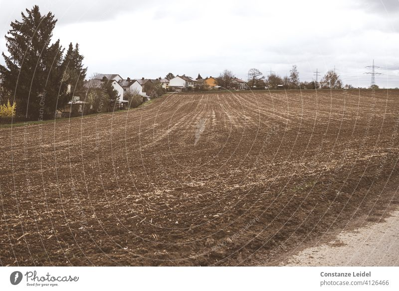 Urban fringe with arable land Agriculture Arable land agricultural landscape Field Nature Rural country Landscape naturally Harvest Sky agriculturally Brown