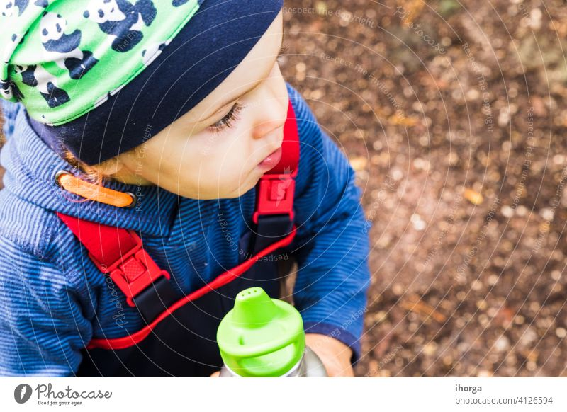 baby playing on a forest path in autumn adventure alone back boy child childhood day fall freedom fun halloween happy hiking independent individual kid