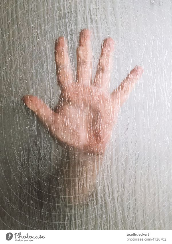 hand behind frosted glass window horror handprint crime mystery thriller male person murder pane bath screen shower screen finger palm violence sex halloween