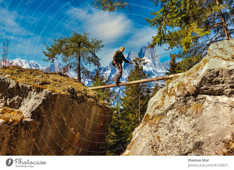 A man walks over a rope bridge Hiking outdoor hicking hike Exterior shot Mountain Vacation & Travel Colour photo Hiking trip hikers Adventure Tourism