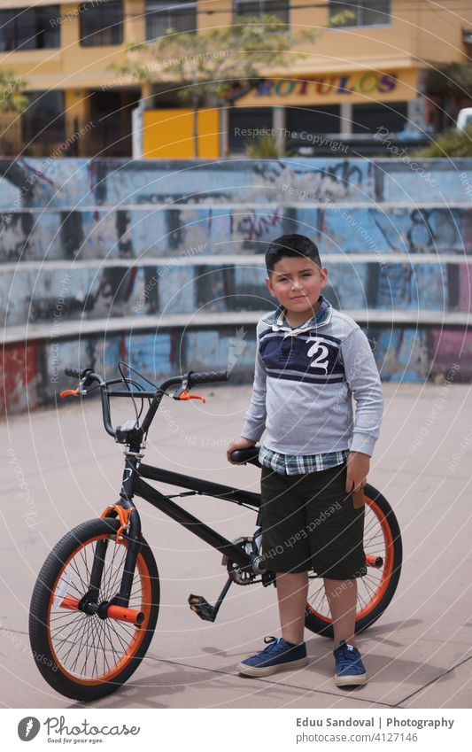 Boy walking with his bicycle. safety ride children childhood exercise activity fun boy lifestyle sport bike recreation healthy leisure people happy helmet
