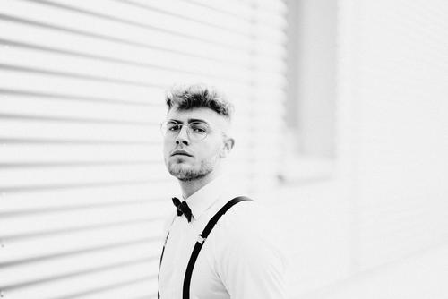 model portrait Masculine Adults Shirt Suspenders Lifestyle 18 - 30 years Young man Cool (slang) Style Fashion Man Attractive fashionable Hair and hairstyles