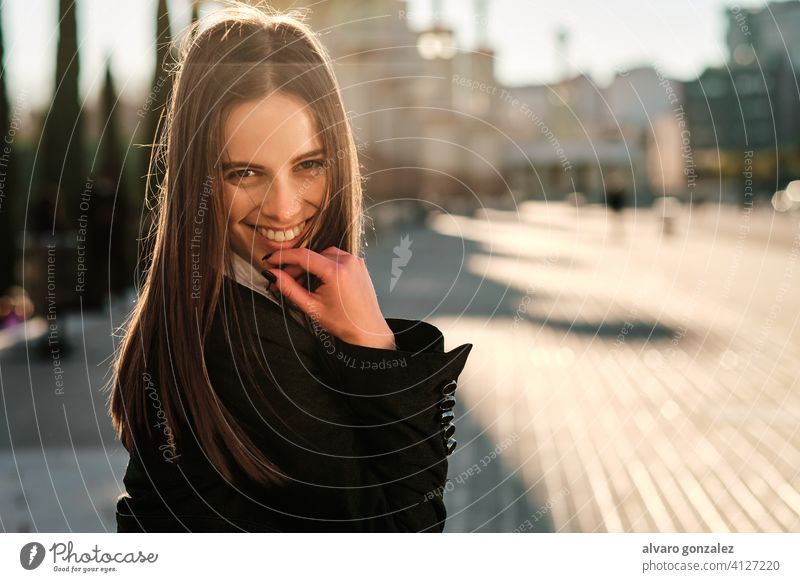 Portrait of young woman smiling outdoors. stylish urban street lifestyle city brunette sombrero day people one elegance looking clothing elegant smile caucasian