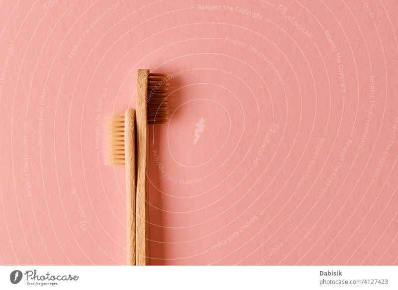 Reusable bamboo toothbrushes on pink background. Zero waste hygiene reusable eco friendly zero waste health clean cleaning dental composition copy space concept