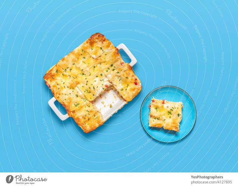 Vegetarian lasagna top view on a blue background. above view bechamel sauce cheese colorful cuisine cut out delicious dinner dish flat lay food fresh gourmet