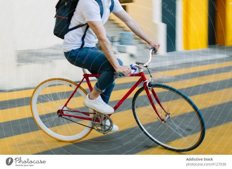 Man riding a bike in the street bicycle fixie urban wheel fixed sport transportation gear lifestyle wall hipster ride pedal man biking chain action cyclist