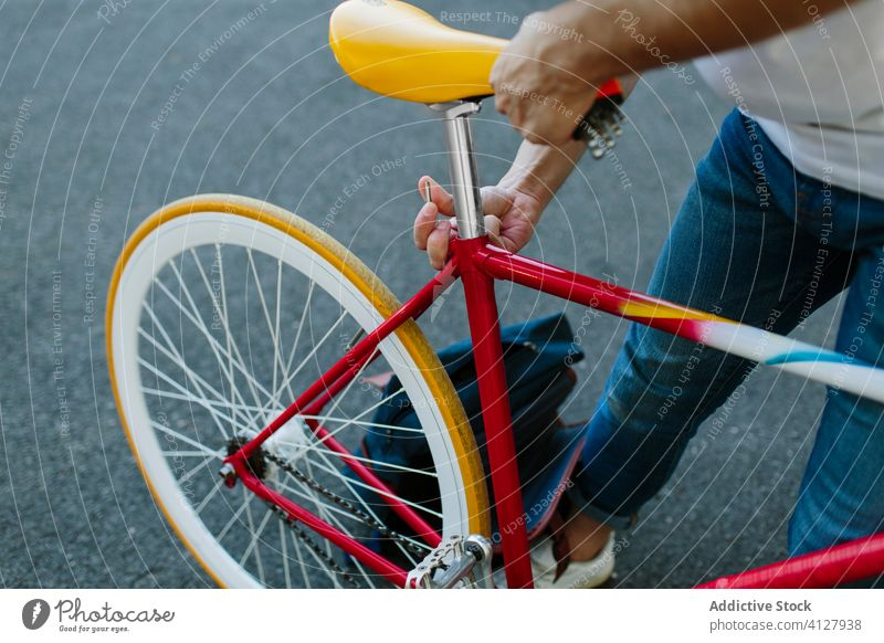 Man setting up a bike bicycle fixie urban wheel fixed sport transportation gear lifestyle wall street hipster ride pedal man biking chain action cyclist outdoor