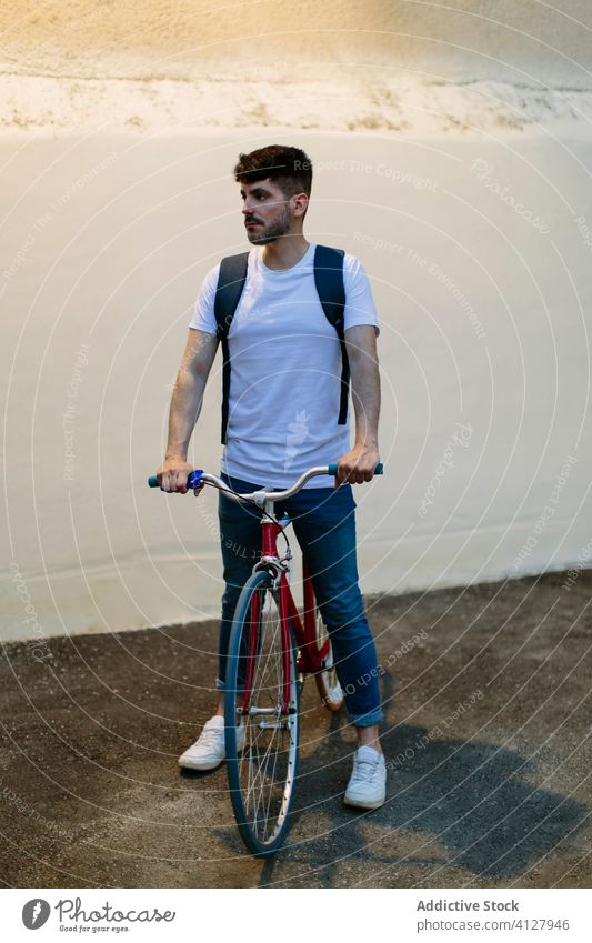 Man riding a bike at night bicycle fixie urban wheel fixed sport transportation gear lifestyle wall street hipster ride pedal man biking chain action cyclist