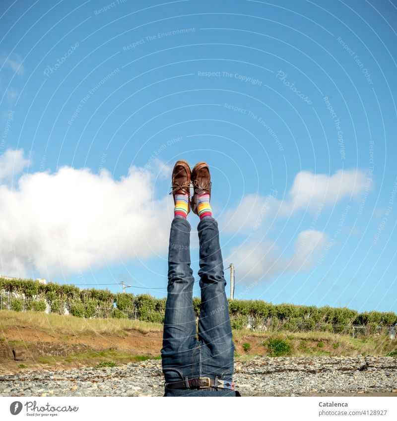 Upside down | yourself Man person masculine Legs Striped pantyhose Jeans Sand Beach Go crazy Sky Beautiful weather cloud Landscape Summer Blue Green Day