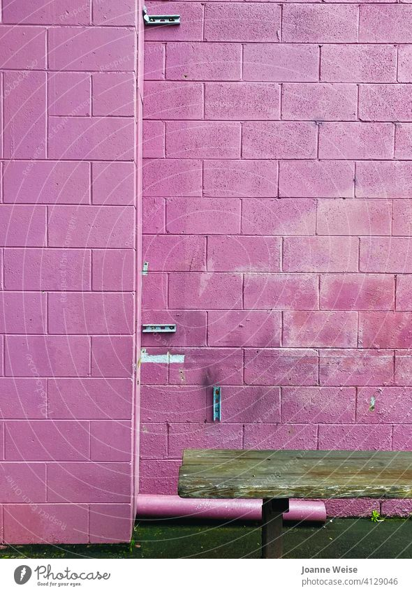 Pink brick wall with brown seat. pink background pink wall Gritty Brick wall Seating Exterior shot Wall (barrier) Wall (building) Facade Old