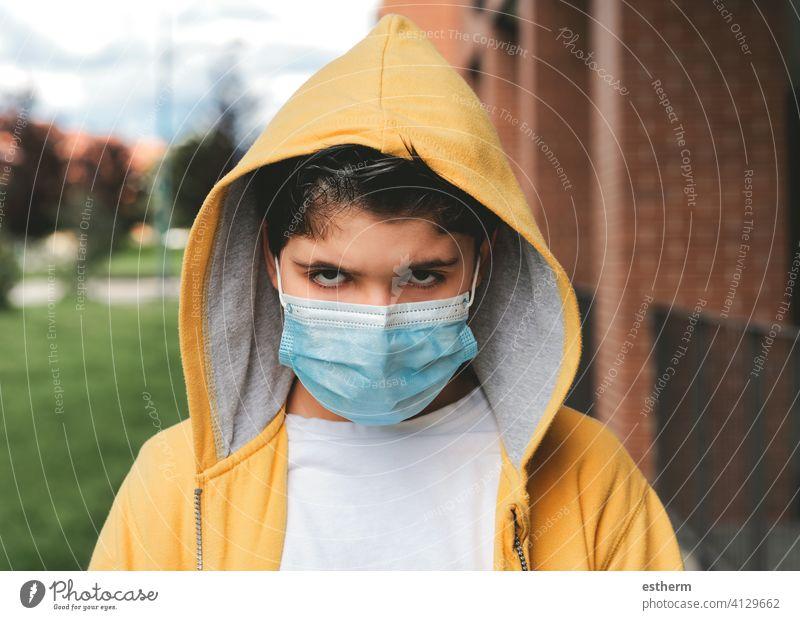 sad and angry kid with protective surgical mask coronavirus child epidemic pandemic thoughtful quarantine covid-19 symptom medicine health death childhood