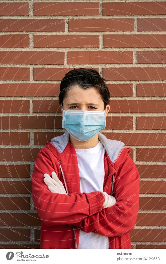 sad and pensive kid with protective surgical mask coronavirus child epidemic pandemic thoughtful quarantine covid-19 symptom medicine health death childhood