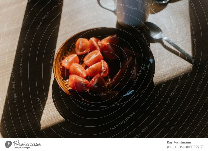 photo of cut tomatoes on a plate appetizer closeup delicious food fresh freshness healthy home indoor lunch meal nourishment nutrition prepare red salad shadow