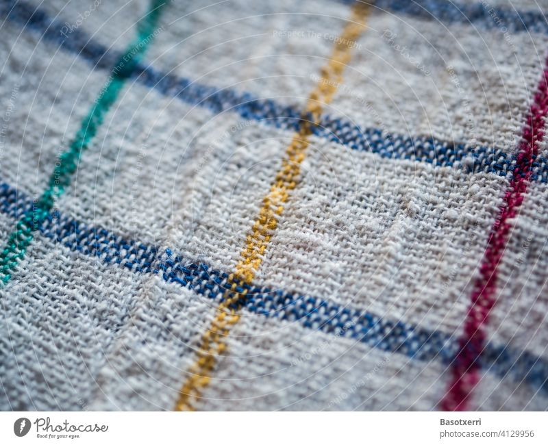 Macro shot of a classic white kitchen towel with pattern of blue, red and green lines Kitchen boil Rag Woven Cloth White Blue Red Green Bright