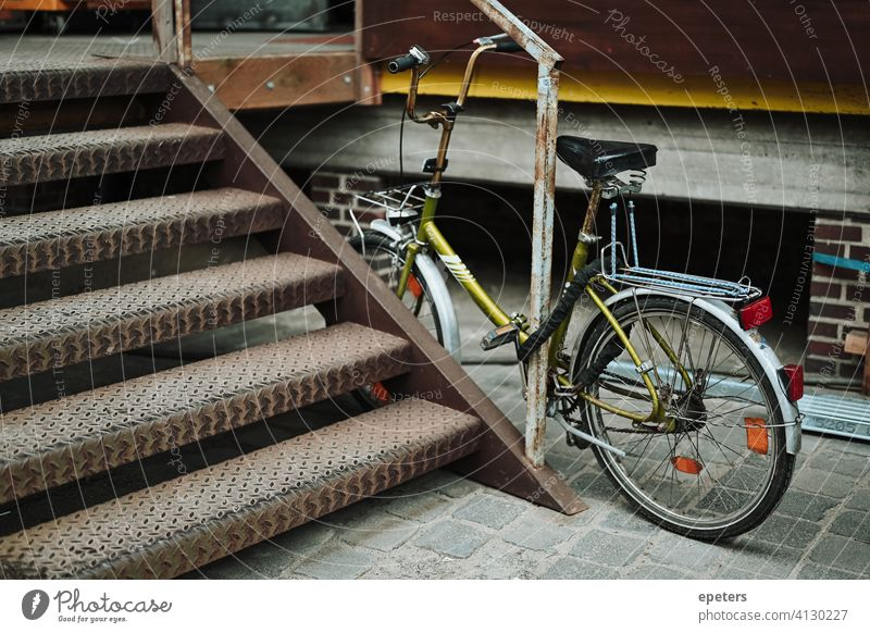 Green bicycle in an industrial warehouse district in Hamburg Germany bike brick wall commute dirty gray grey industrial style pretty transport transportation