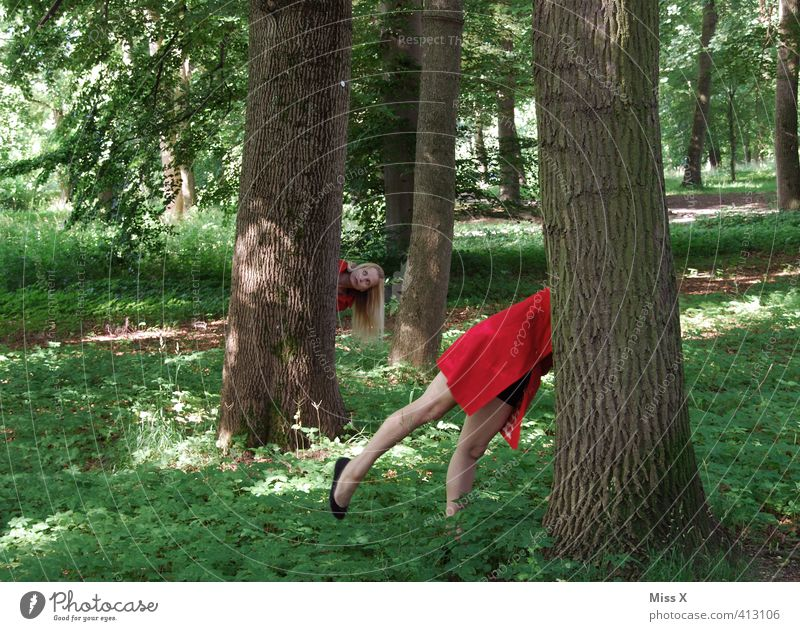 Here I am! Playing Children's game Human being Feminine Woman Adults 18 - 30 years Youth (Young adults) Tree Forest Funny Red Search Hide Hiding place