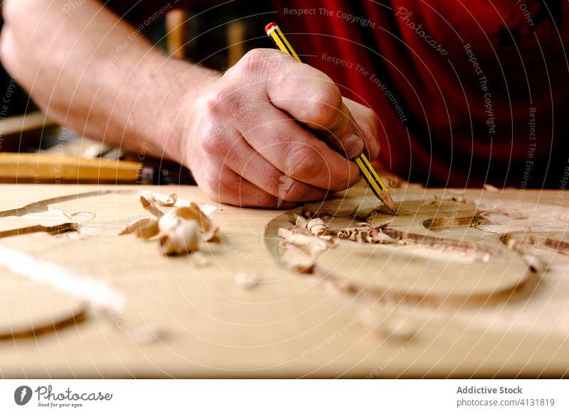 Craftsman carving elements on wood in workshop carve chisel woodwork craftsman ornament tool equipment woodworker artisan male professional occupation job skill