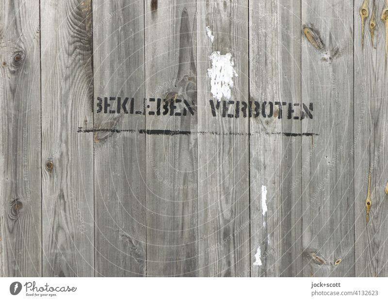 STICK ON FORBIDDEN Wooden wall Hoarding Wooden fence Inscription Bans Typography Stencil letters Vandalism Characters Wooden board Word Ravages of time