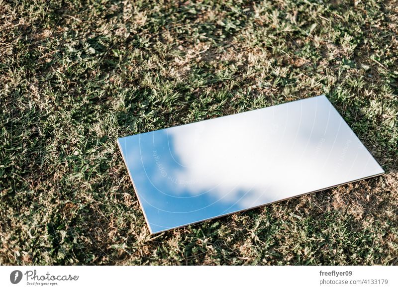 Amazing flat lay of a mirror on the grass background abstract sky mockup copy space rectangle clouds nature light natural no people nobody organic shape simple