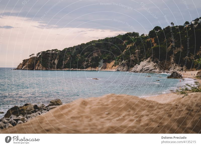 Image of a mediterranean cove on a Spanish beach Rock peaceful scenery stone holiday bay horizon serene location travel summer spain tranquil explore wonderful