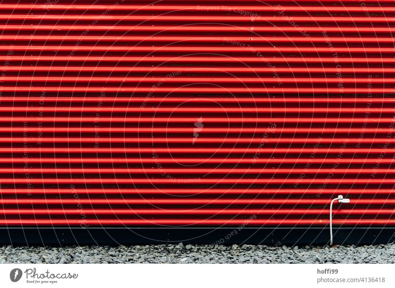 red striped facade with white grounding cable Red Striped Corrugated iron wall with red stripes Wall (building) red facade Facade Minimalistic