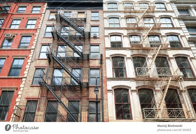 Old buildings with iron fire escapes, New York City, USA. city Manhattan old townhouse architecture stairs apartment facade NYC ladder view residential urban