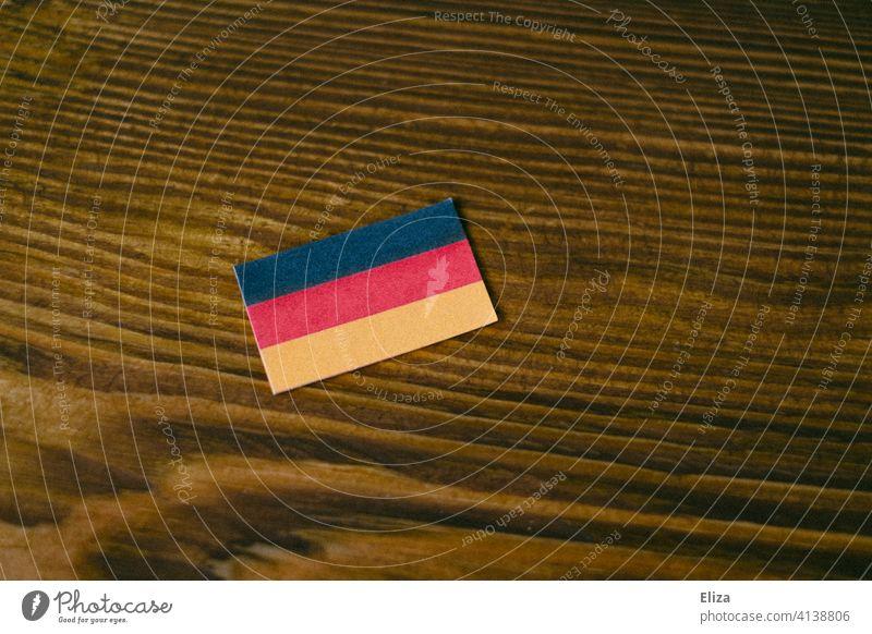 Germany flag on wood German flag Wood German Flag Ensign Patriotism black red gold