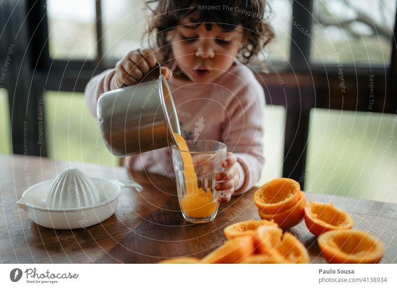 child making orange juice Child Orange Orange juice Juicy Juice Vitamin Organic produce Citrus fruits Colour photo Nutrition Fresh Food Vitamin C Fruit Healthy