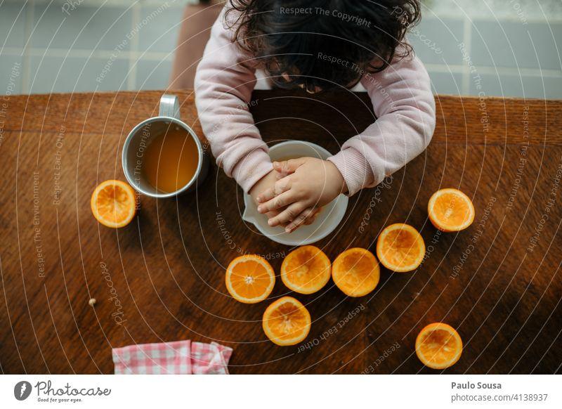 Child making orange juice at home 1 - 3 years Caucasian Bird's-eye view view from above Orange Orange juice citrus Vitamin Vitamin C Fruit Juice Citrus fruits