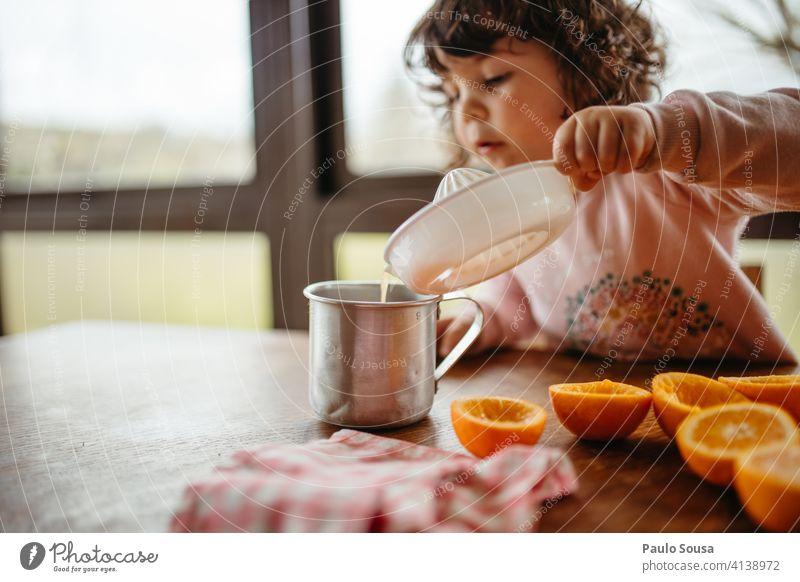 child making orange juice Child 1 - 3 years Caucasian Orange Orange juice Colour photo Human being Juice Infancy Fruit Healthy childhood Juicy Food Nutrition
