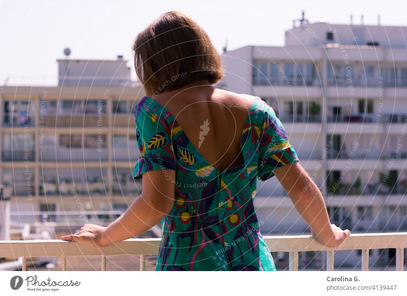Woman on a balcony in a sunny morning Young woman Balcony Sunlight indoors Quarantine confinement isolation Isolated female quarantine coronavirus pandemic