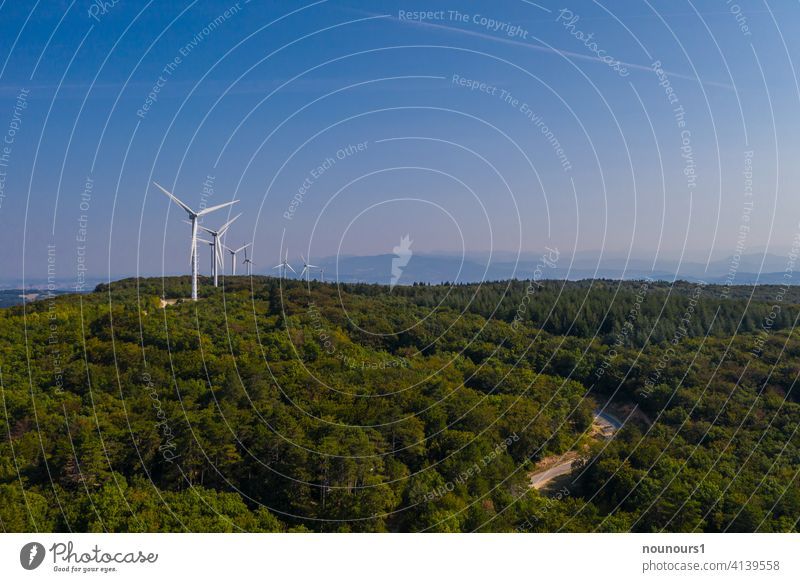 Wind farm in the forest generates electricity Wind energy plant Sky Energy industry Electricity Industry Ecological Renewable energy Environment Alternative
