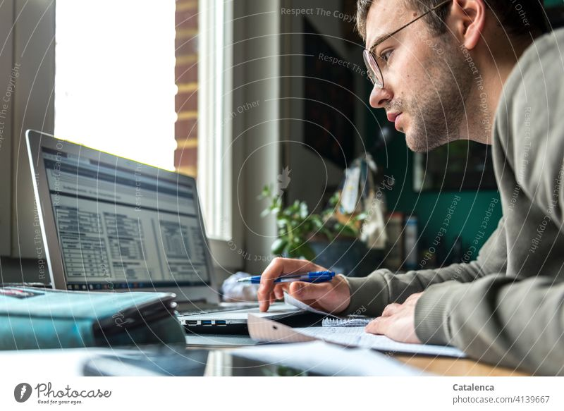 Young man working on laptop, online lecture labour at home home office Study Lecture Online Internet portrait Education Desk Window Workplace Computer